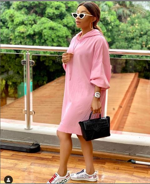 "Toke Makinwa looks stunning as she steps out in pink outfit, she captioned it ""Ice princess for cool kids only"""