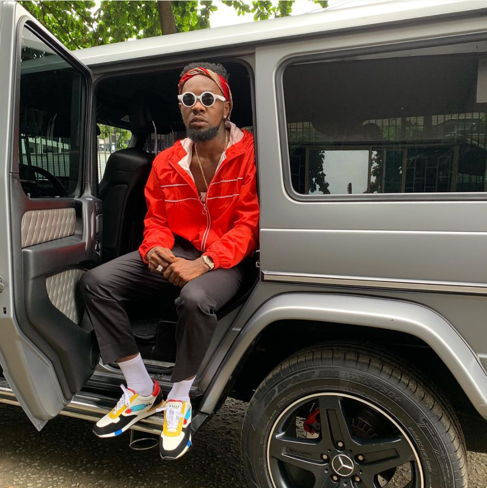 """The Nigerian Singer, Patoranking pictured in his G-Wagon ride, he captioned it """"Success Never comes to Anybody Hating"""""""