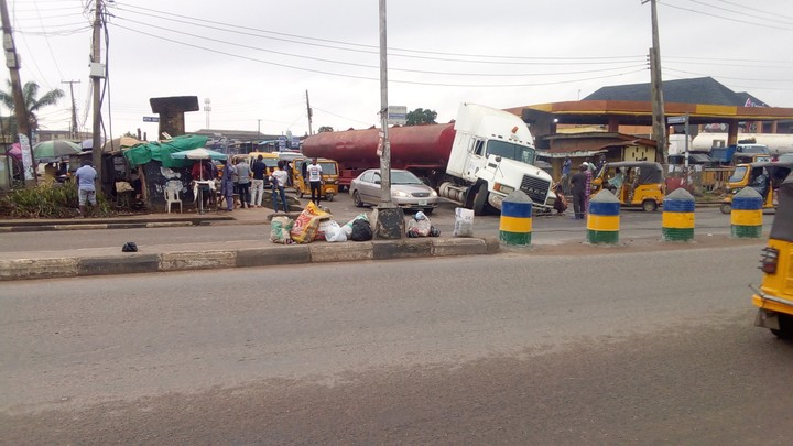 Due to bad road a trailer just lost its Balance, falls into a Pit Hole around Ikotun Lagos.