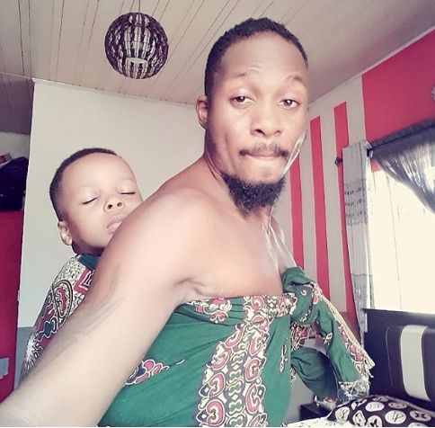Actor Junior Pope Odonwodo shared a photo of himself backing his son and explained why.  He wrote on Instagram:  He Insisted To Be Backed And Since Mum @dopeevents007 @qutejay Is Not Around……..Daddy Got To Step Up.. #familyiseverything