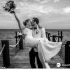 England captain Harry Kane and childhood sweetheart Katie Goodland married at an exotic resort. Kane, who is enjoying some time off following England's involvement in the UEFA Nations League earlier this month, posted photos of the newly weds on his Twitter page. One photo shows Kane, wearing a white suit and a black bow-tie, lifting his wife, who stood out wearing a fitted sweetheart neckline dress, while stood on a jetty. Kane wrote on Twitter: 'Finally got to marry my Best Friend! I love you @KateGoodlandx'