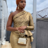 A former Big Brother Naija housemate, Bambam stormed a wedding ceremony looking all classy and sharp. Big Brother Naija star, Bamike Olawunmi, popular known as BamBam stepped out for a wedding over the weekend and she stunned people there with her outfit. The BBNaija star who is also an entrepreneur, was seen rocking a gold coloured dress and she stole the hearts of her fans with the look. See another photo below: