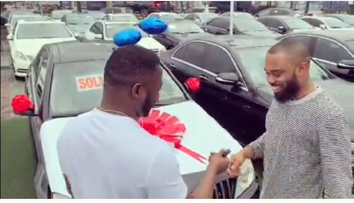 """Comedian and singer, MC Galaxy gift music producer, Tspise a bran new Mercedes Benz for producing his hit song 'Sekem' five years ago.  Five year ago I did not have the full money to pay him for the production of """"sekem"""" but five years later God has blessed me so much so I decided to Appreciate my brother @tspize with a benz C 300 I love you bro and more to come Amen. S/O to @ivd001"""