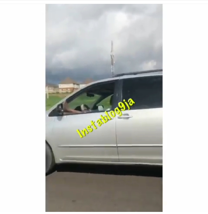 Man places his leg on the window, as he smokes while driving on an expressway in Abuja…