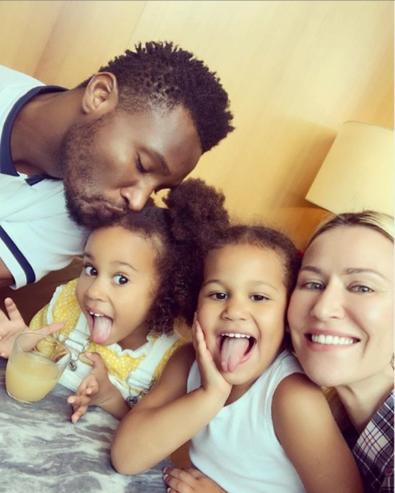 Super Eagles Captain, John mikel obi's shared this adorable photo of his Russian partner, Olga Diyachenko, and their beautiful twin daughters, Ava and Mia calling them his world and everything.
