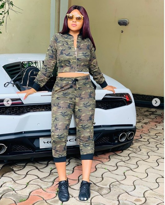 """Nollywood actress Regina Daniels is obviously living her best life, and she never misses an opportunity to show it. The teen actress posed with her billionaire husband Ned Nwoko's white Lamborghini in his Abuja house, rocking a camouflage. """"Having a soft heart in a cruel world is a courage not a weakness"""" she captioned the photos."""