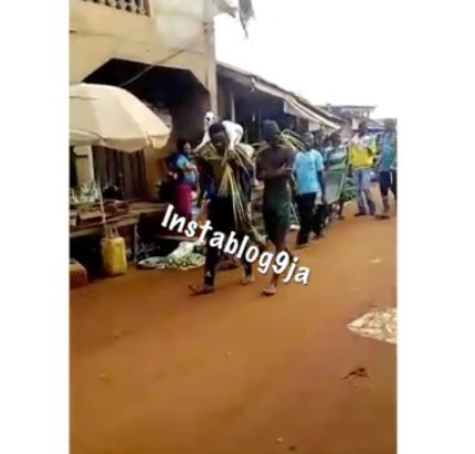 Two young men paraded after being nabbed trying to sell an old woman's stolen goat in Eke market, Anambra.