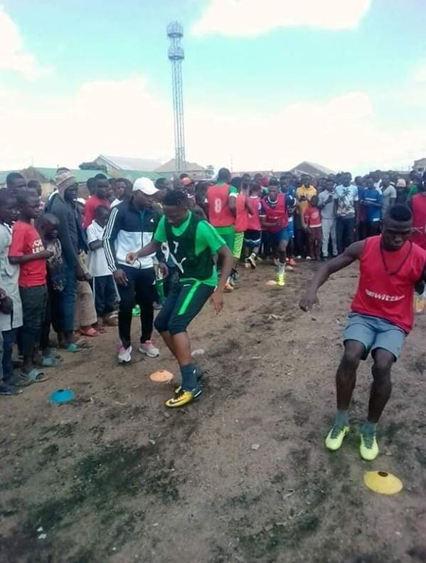 Super Eagles Captain Ahmed Musa was pictured training with locals at Baptist Primary School Pitch,Bukuru,Jos.This is the pitch he started playing football while growing up.He was born in Bukuru.