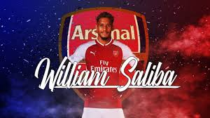 According to a recent report from Sky sources, Arsenal are getting closer and closer to agreeing a deal with French club Saint-Etienne over the signing of defender William Saliba. The deal would, interestingly enough, see him go straight back out on loan to Saint-Etienne next season, which would still leave the Gunners needing reinforcements at the back ahead of the new Premier League campaign. Tottenham were also interested in signing him but have yet to put forward a formal offer, meaning that Saint-Etienne are going to wait until they do so before deciding who to sell him to. It seems like this tactic is being done in order to try and increase the price that they receive for him, but even with their intervention, Saliba is apparently more interested in the idea of playing for Arsenal. Either way, the Premier League is going to have a brand new defender on their books very soon. Source:- SoccerNews