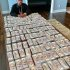 """Retired boxer heavyweight, Floyd Mayweather displays plenty wards of dollars cash, revealed this is what he had being hearing for 23years. He wrote; This is what I've been hearing for 23 years… """"All Mayweather does is brag about his cars, his jewelry, his mansions, his ladies, his clothes and his money """". And this is what Mayweather says back… """"I'm happy y'all spent over 2 decades hating on me instead of building your own legacy """""""