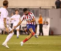 Diego Costa scored four goals as Atletico Madrid humiliated LaLiga rivals Real Madrid 7-3 in an incredible display at the International Champions Cup. Atletico showed no mercy in New Jersey, where Diego Simeone's men led 5-0 at half-time thanks to Costa's first-half hat-trick on Friday. Big-money signing Joao Felix scored his first goal since arriving from Benfica and set up two others, while Angel Correa was also on target in a sensationally one-sided first half at MetLife Stadium. Costa teamed up with Joao Felix to add his fourth six minutes into the second half before he was sent off after clashing with Dani Carvajal, which sparked a melee. Vitolo scored a sensational solo goal in the 70th minute after Nacho Fernandez reduced the deficit on the hour-mark, while Madrid substitute Karim Benzema converted an 85th-minute penalty and Javi Hernandez bundled the ball over the line late. Atletico were ruthless from the outset, last season's runners-up breaking the deadlock after just 43 seconds when Joao Felix played a neat pass to Costa, whose deflected shot beat Thibaut Courtois. That was a sign of things to come as Joao Felix made it 2-0 less than seven minutes later – the former Benfica teenager stepping in front of Marcelo and side-footing from close range after Saul Niguez cut a pass back into the penalty area. After a lively Alvaro Morata left the field due to an apparent calf injury, his replacement Correa – linked to AC Milan – put Atletico 3-0 ahead in the 19th minute with a volley past Courtois. While Joao Felix and Costa continued to wreak havoc, Madrid's woes were compounded by what appeared to be a knee injury to new signing Luka Jovic, who had to be substituted following a collision with Atletico goalkeeper Jan Oblak. Madrid's defensive problems were highlighted again as Atletico went 4-0 ahead in the 28th minute – Saul winning the ball after a bad pass from Ramos and sliding in a simple pass for Costa and he made no mistake. Hermoso and Thomas Lemar also 
