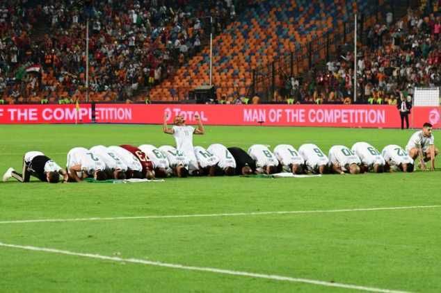 Algeria won the Africa Cup of Nations for the second time on Friday night with a 1-0 win over Senegal in the final in Egypt, MySportDab reports. Baghdad Bounedjah scored the only goal in the second minute with a shot which took a wicked deflection off Salif Sane – standing in for the suspended Kalidou Koulibaly – and looped into the net, past Alfred Gomis. Algeria had already beaten Senegal during the group stage of the competition, and victory never looked in doubt, with Sadio Mane and co. unable to ever test Rais M'Bolhi throughout. After the final whistle, Algeria players gathered together and prayed in an iconic moment.
