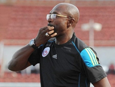 """The Super Eagles assistant coach, Imama Amapakabo, has spoken up about what revered cleric, T.B. Joshua told him before the Nigeria vs Algeria match. Nigeria's Super Eagles Assistant Coach, Imama Amapakabo, has disclosed what the General Overseer of the Synagogue Church of All Nations, SCOAN, Prophet T.B. Joshua told him before the Super Eagles vs Algeria Semi-finals match in Egypt. According to him, Joshua on the eve of the match called him and told him that whoever won the encounter would go on to take the coveted trophy. """"Got a call from Prophet T.B. Joshua on the eve of our game against Algeria and he prophesied that we should play that game as the finals – in other words, whoever wins the game wins the cup and true to his words, it came to pass,"""" he said on his Facebook page on Saturday. The Algerian team who defeated the Super Eagles 2-1 later went on to win the tournament."""