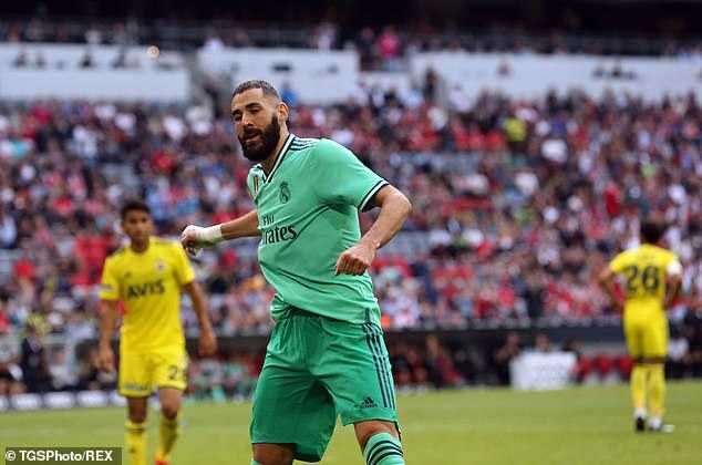 Striker Karim Benzema scored a stunning Hat-trick as Real Madrid defeated fenerbahce 5-3 in a thrilling Audi Cup match today, MySportDab reports.