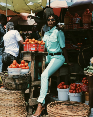 Popular singer Seyi Shay look Stuning and radiant as she becomes a pepper seller in a new photoshoot at a market for an upcoming video shoot.
