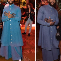 See The Outfit Jidenna Wore To An Event That Is Trending On Social Media Jidenna attended the Harper's Bazaar Icons Party in New York last night in thisKenneth Nicholson powder blue attire.