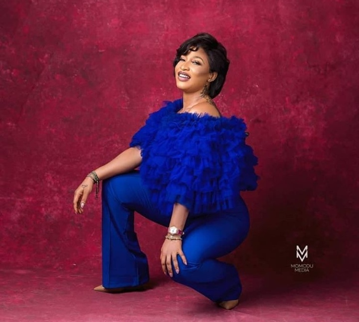 Actress Tonto Dikeh who is a mother of one, strikes poses as she dazzles in all blue. She rocks in a ruffle blue blouse with a matching pant trouser.