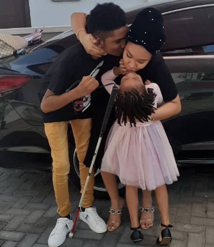 """Anna Ebiere shared an adorable photo showing her receiving a kiss from her baby daddy's adopted son and her daughter.  In the photo, Semah G. Weifur, a visually-impaired young Liberian who Flavour adopted, is seen planting a kiss on Anna Ebiere's cheek while Anna and Flavour's daughter, Sofia Okoli is seen kissing her mother on the lips.  """"The joy of a mother,"""" the former beauty queen captioned the photo."""