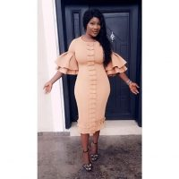 Actress Mercy Johnson rocks her voluptuous figure in this chic gown looking so adorable. She shared the photos on her social media space wishing her fans a happy sunday.