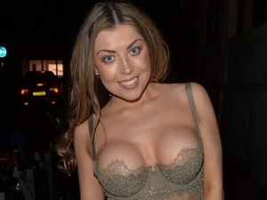 British model and actress Abigail Clarke were going out in the club and she surprised everyone with her serious cleavage and with her brand new breasts and she looked amazingly good in that black dress.