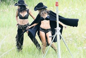 Brazilian super models Adriana Lima and Alessandra Ambrosio were minding their own business and exposing their curves in cowboy styled lingerie when a nosy pervert decided to snap a few sneaky pictures of them.