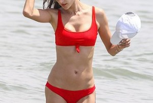 The most beautiful lady of Brazil, Alessandra Ambrosio. If you think that's an overstatement just browse through this impressive set of her photos. She's a gorgeous 37 years old brunette with long brown haired and a pretty much perfect body. Get ready for some super hot paparazzi pics. She's caught on the beach in a red bikini which suits her perfectly.