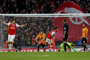 Pierre-Emerick Aubameyang scores his 50th Arsenal goal as Wolves come from behind to held Gunners 1-1 in the Premier League encounter at Emirate Stadium on Saturday evening. Gabon international handed the armband in Granit Xhaka's absence while crowd-favourite Mesut Ozil was restored to the line-up, the Gunners were far from convincing.Arsenal's greater quality in the final third had given them the edge at the interval when Alexandre Lacazette showed great composure to feed Aubameyang for the opener.Lacazette collected David Luiz's deflected cross and squared for his strike partner to slot the ball beyond Rui Patricio. The Gunners missed a great chance to double the lead minutes later as Conor Coady and Leander Dendoncker made a mess of dealing with Callum Chambers' cross, but Torreira could only shoot straight at Rui Patricio.The visitors began the second half as they had the first, putting Arsenal under pressure, and the anxiety was tangible around the Emirates, particularly whenever the ball was at Leno's feet.But it was Arsenal's defensive frailties that would eventually show once more, as they were caught napping by a quick throw-in and Jimenez got up between Chambers and Sokratis to head home.
