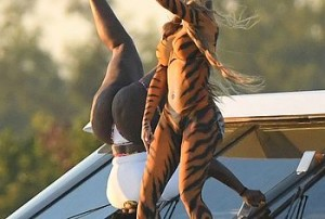 Did we see a pussy- cat? We thought we saw a pussy- cat! Oh, no it is Cardi B, with full body paint, dancing and twerking on the beach, showing that big, round ass and hot cameltoe to everyone and obviously having tons of fun with friends.