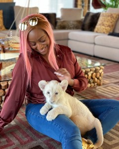 """DJ Cuppy plays with a baby lion named after her, feeds the cub.  She said:  """"Introducing the world to """"Cuppy"""" the newest baby lion named after ME by @Sb_Belhasa owner of @Fame.Park. I've always wanted to be a mother!"""""""