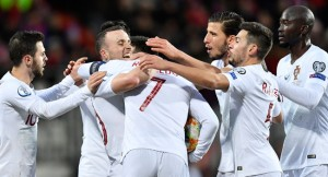 Cristiano Ronaldo scored his 99th international goal as reigning champions Portugal secured their place at the Euro 2020 finals on Sunday with a 2-0 victory away to Luxembourg. Bruno Fernandes struck the opening goal on 39 minutes before Ronaldo tapped in a scrappy second late on to clinch second place in Group B behind winners Ukraine, who drew 2-2 in Serbia.