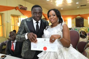 """Festus Keyamo's Sister, Miriam Weds Harrysong's Manager, Desmond Ike (Photo) Miriam Keyamo, Minister of Labour and Employment Festus Keyamo's younger sister walked down the aisle with her heartthrob Demond Ike on Saturday November 23. The couple tied the nuptial knots at Decorium Event Centre in Oregun, Lagos after 10 months of dating. """"When we met at Festus Keyamo Chambers where I work, little did I know we were going to date; how much more marry. Everything happened like a joke and so fast,"""" the bride said."""