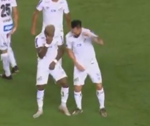 Santos midfielder, Marinho has introduced a VAR celebration after he scored an out of the box goal.  As soon as the ball hit the back of the net and his teammates rushed to celebrate with him, he freed himself from their midst.  He then made the hand gesture done by referees when they want a decision to be made via VAR.