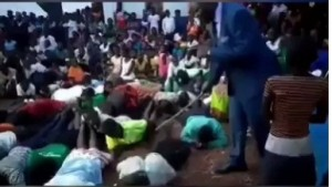 A new video has emerged on the internet wherein controversial Pastor Paul Muwanguzi was spotted flogging his church members for allegedly failing to attend church service which held recently.