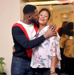 "Big Brother Naija's Frodd is in a happy mood as his mother turns a year older. The reality star showed off his mother on Instagram and showered her with love as he celebrated her birthday. ""Happy 50 to my Prayer Warrior . , I love you so much mum,"" he captioned photos of him and his mum."