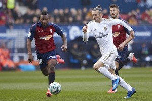 Gareth Bale came back into the team and Real Madrid came back to beat Osasuna on Sunday as a 4-1 victory in Pamplona strengthened their hold on top spot in La Liga.