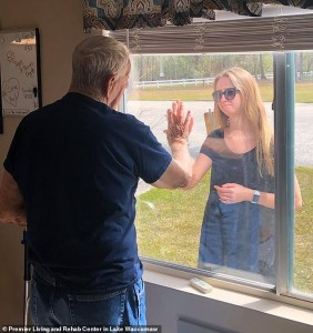 Coronavirus: Heartbreaking Photos Show Woman Showing Off Her Engagement Ring To Her Grandfather Through The Window Of His Nursing Home Because She Can't Go Inside